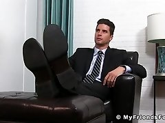 Classy jock in suit enjoying is some sloppy feet deep-throating