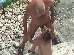 old & young gay-for-pay bottom naturist at the beach