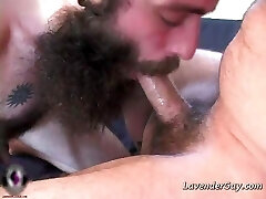 Two bearded gay folks are sucking hard