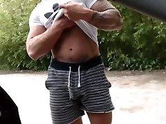 Bearded tattooed guy masturbating off