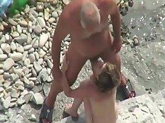 old & youthful hetero bottom nudist at the beach
