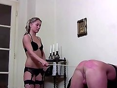 Two mistresses take turns in hard cropping their victim
