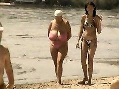 Retro big bra-stuffers blend on Russian beach