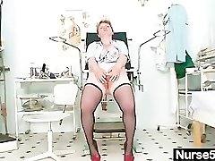 Filthy mature lady toys her hairy cunt with speculum