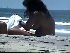 Bare couple at the beach
