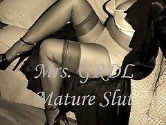 Mature Slut Taunts in Retro Undergarments (slideshow)