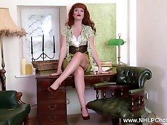 Redhead babe unclothe teases showing nyloned legs bare pussy