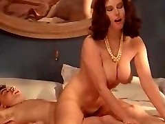 Retro busty MILF enjoys barred cock