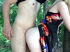 Wife romping husbands friend in the park
