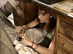 Slutty secretary gives her manager a blowjob under the table