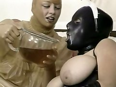 2 kinky chicks in latex outfit slurp each other snatches in 69 style
