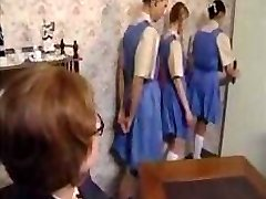 Naughty schoolgirls line up for their ass slapping punishment
