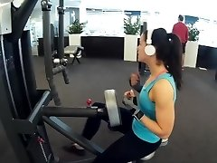 Fitness girl instructing biceps triceps