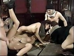 Anita Dark participates in old school gangbang with her fucked-up mates
