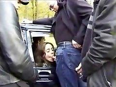 Oral lovin' French slut sucks dicks in public in a car
