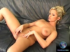 Danielle strips nude exposing her huge tits and fresh pussy