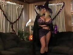 Halloween Cougar with very huge silicone tits