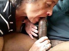 Greedy grandma eating a meaty black cock
