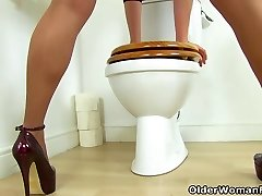 British milf Abi works her nyloned fanny on rest room