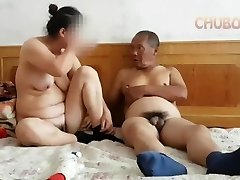 Chinese grandpa giving it to grannie from behind