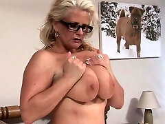 Big-titted blonde tries out a dildo