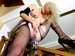 Blonde in high heels, spreads pussy with piercings