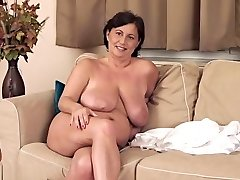 Mellow busty old female haning an awesome masturbation