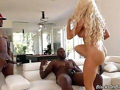 Fake tittied blond milf Nikki Delano is plowed stiff by two black dudes