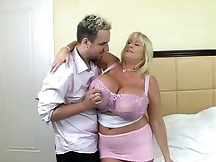 Blonde mature with good-sized silecone tits