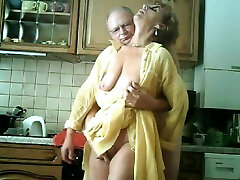 Eating a fingering granny's snatch