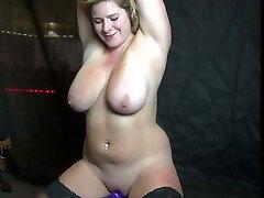 Blonde slut with massive bra-stuffers rides sybian
