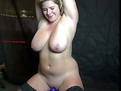 Blonde slut with massive bra-stuffers rides sybian