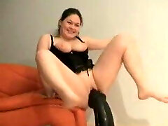 Chubby girl trying to ride a Huuuuuge dildo