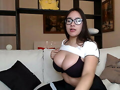 Girl with glasses licks her perfect globes
