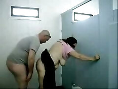 Old dude fucks this round huge-chested granny in a public toilet