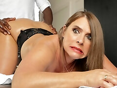 Horny cougar with huge tits calls in for anal massages
