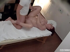 Gorgeous round redhead fucks her masseuse