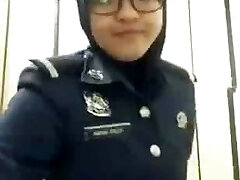 arab police doll taking her hijab out and flash her booty