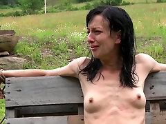 Anorexic brunette hussy gets her slim body tied up to wooden fence outdoors