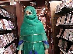 Red-hot Pakistani damsel Nadia Ali deep-throats big dick in the glory hole room