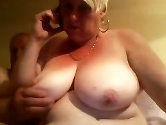Fat old blonde amateur granny stretches her plump pussy wide