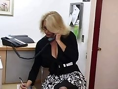 Mature secretary gets cum on her giant breasts