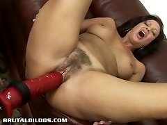 Brunette milf is fucked hard by a ferocious dildo machine