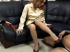 Yuuko puts feet in footwear on phallus