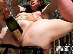 Extreme double handballing and giant bottle insertions