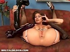 Busty babe Felony crams her pussy with a monster fake penis
