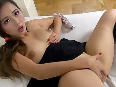 Japanese schoolgirl fucks herself