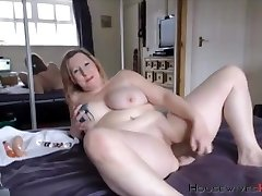 Bbw mature Carmen with huge tattooed tits rides a fake penis