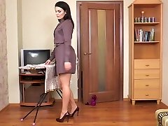 Wooly cougar Kristina Ray does the household chores