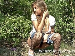 Hairy lady Riana S enjoys her walk outside